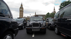© London News Pictures. 17/07/2012. London, UK.  Black Cab Taxi drivers block up Parliament Square in Westminster, London on July 17, 2012 to demonstrate against not being allowed to use the official Olympic lanes during the London Olympic Games. Photo credit: Ben Cawthra/LNP.