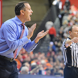 Rutgers Scarlet Knights head coach Mike Rice applauds his players during second half NCAA Big East basketball action between #2 Syracuse and Rutgers at the Louis Brown Athletic Center. Syracuse defeated Rutgers 74-64.
