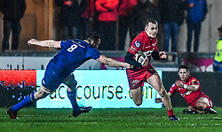 Scarlets' Ioan Nicholas evades the tackle of Leinster's Jack Conan<br /> <br /> Photographer Craig Thomas/Replay Images<br /> <br /> Guinness PRO14 Round 17 - Scarlets v Leinster - Friday 9th March 2018 - Parc Y Scarlets - Llanelli<br /> <br /> World Copyright © Replay Images . All rights reserved. info@replayimages.co.uk - http://replayimages.co.uk