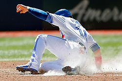 May 13, 2018 - Toronto, ON, U.S. - TORONTO, ON - MAY 13: Toronto Blue Jays First base Justin Smoak (14) slides home safe during the MLB game between the Boston Red Sox and the Toronto Blue Jays on May 13, 2018 at Rogers Centre in Toronto, ON. (Photo by Jeff Chevrier/Icon Sportswire) (Credit Image: © Jeff Chevrier/Icon SMI via ZUMA Press)