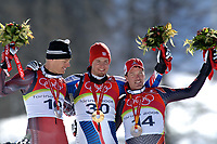 Photo: Catrine Gapper.<br /> Winter Olympics, Turin 2006. Alpine Skiing Downhill. 12/02/2006.<br /> Michelle Walchhoffer (Austrian silver medalist), Antoine Deneriaz (France Gold medalist) and Bruno Kernen (Switwerland's Bronze medalist) celebrate their victory.