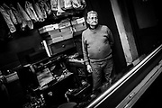 David Martins stands in his shoe repair shop. Mr. Martins started working at eight years old on October the 5th, the anniversary of the Implementation of the Republic after the overthrow of monarchic rule. At the time of Mr. Martins' first working day, still a child, the date was a normal business day. The date would later be established as a national holiday, one of the most important ones to be celebrated, rejecting absolutism and celebrating democracy. In 2013 the date will no longer be a holiday once again, a government measure to cut deficit by reducing public holidays. Mr. Martins, now 78, earns a pension of a couple hundred euros which doesn't allow him to stop working. For him, who since his eight years old never stopped working, this is a circle that now closes, back to days when the date was a normal labour day with no celebrations of revolution, popular sovereignty or democracy and when nothing was illegal in face of a rising world of capitalism. Not even child labor.