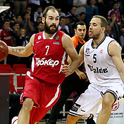 Besiktas's Muratcan Guler (R) and Olympiacos's Vassilis Spanoulis (L) during their Turkish Airlines Euroleague Basketball Top 16 Game 9 match Besiktas between Olympiacos Piraeus at Abdi ipekci Arena in Istanbul, Turkey, thursday, February 28, 2013. Photo by Aykut AKICI/TURKPIX
