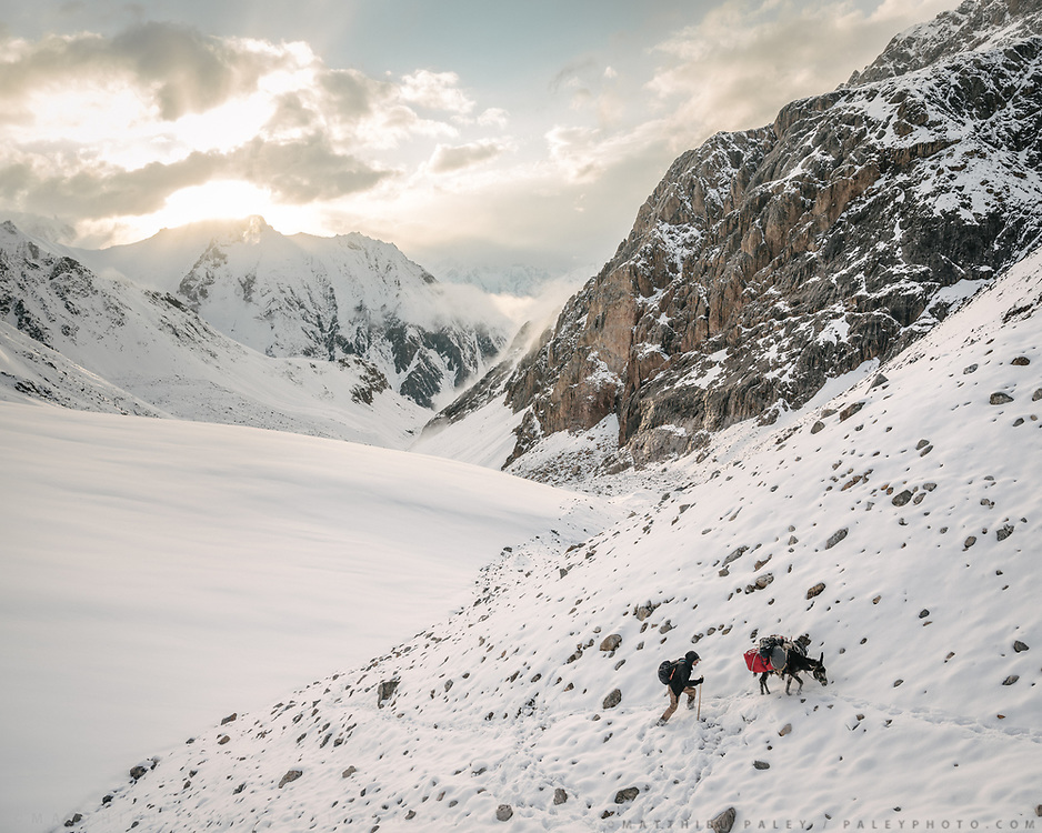 """Going over the challenging Irshad Pass (4950m) into Pakistan. It snowed for 36 hours straight. These are Paul Salopek's last foot steps in Afghanistan. We walked all day in fog, losing the way, I was literally pushing donkeys up. Guiding and photographing Paul Salopek while trekking with 2 donkeys across the """"Roof of the World"""", through the Afghan Pamir and Hindukush mountains, into Pakistan and the Karakoram mountains of the Greater Western Himalaya."""