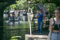 © Licensed to London News Pictures. 23/06/2020. London, UK. Members of public are seen walking by the canal in Camden Town, north London. Key to easing the lockdown in England will be the two-meter rule - the distance people should stay apart to stop catching coronavirus. Photo credit: Marcin Nowak/LNP