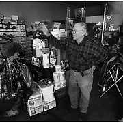 Frank Craft waves goodbye to a customer at his hardware store on Dickinson Avenue.