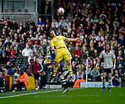 MK Dons Forward Alex Revell (18) heads away during the Sky Bet Championship match between Fulham and Milton Keynes Dons at Craven Cottage, London, England on 2 April 2016. Photo by Jon Bromley.