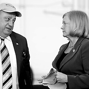 2/7/11 -- BRUNSWICK, Maine. Maine Gov. Paul LePage, left, chats with Congresswoman Chellie Pingree at the ceremony to pass Hangar 6 from the Navy to the Midcoast Regional Redevelopment Authority. The ceremony was a host of local and state government representatives. Roger S. Duncan Photo / For The Forecaster