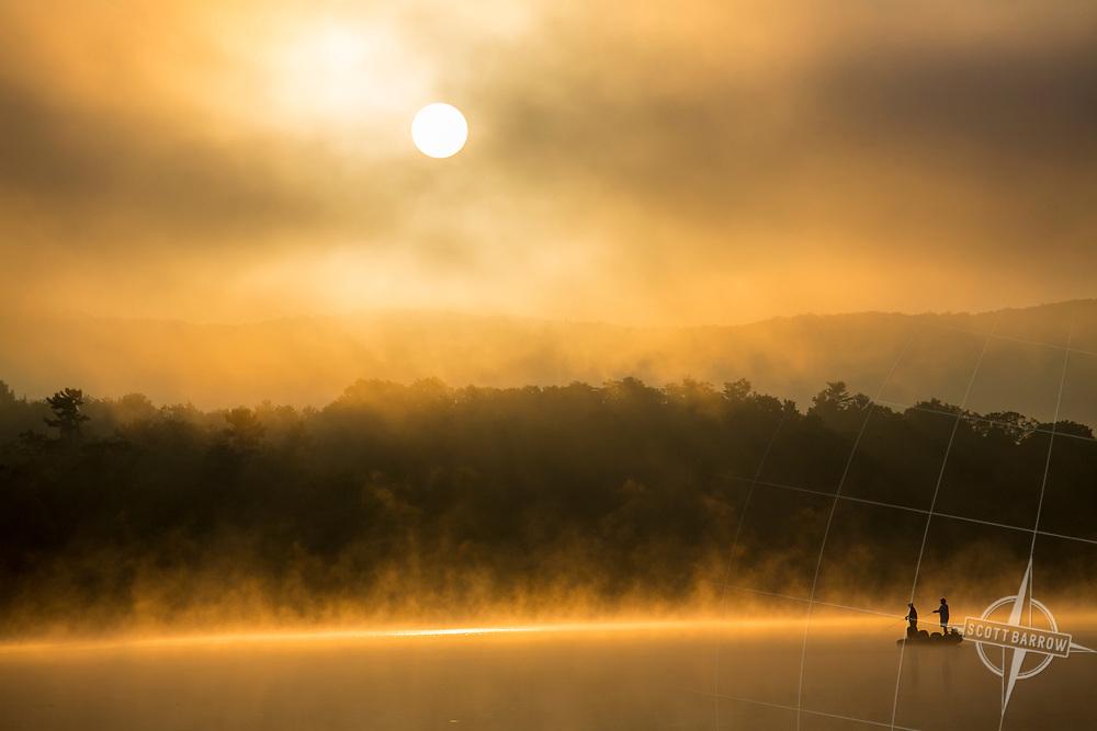 Men fishing at sunrise on Laurel Lake