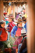 Quechua women buying and selling at Chinchero Town Sunday Market, Cusco region, Peru, South America