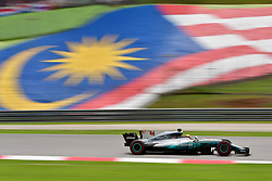 SEPANG, Oct. 1, 2017  Mercedes driver Lewis Hamilton of Britain drives at the Formula One Malaysia Grand Prix at the Sepang Circuit in Malaysia, on Oct. 1, 2017. Max Verstappen claimed the title of the event. (Credit Image: © Chong Voon Chung/Xinhua via ZUMA Wire)
