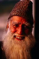 Kashmiri carpet merchant Prof. Butt at Indo Kashmir Carpet Factory, New Delhi, India