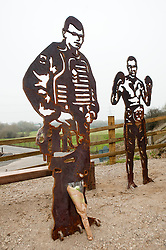 """Statue of Cpl Liam Riley who Prince Harry Described as """"a Legend""""..Cpl Liam Rileys mum Cheryl and his sister Olivia paid tribute to Liam who was killed in killed in Helmand province Afghanistan on 1 February 2010 while serving with 3rd Battalion The Yorkshire Regiment (3 YORKS) this morning during the unveiling of The Portrait Bench at Killamarsh. Statues standing along side Liam are Sheffield Boxer and former British, Commonwealth, European and World titles holder Clinton Woods and Local Community volunteer worker Colin Savage..http://www.pauldaviddrabble.co.uk.14 March 2012 .Image © Paul David Drabble"""