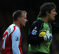 Photo: Javier Garcia/Back Page Images<br />Arsenal v Fulham, FA Barclays Premiership, Highbury, 26/12/04<br />Dennis Bergkamp wins the battle of the dutchmen with Edwin Van Der Sar