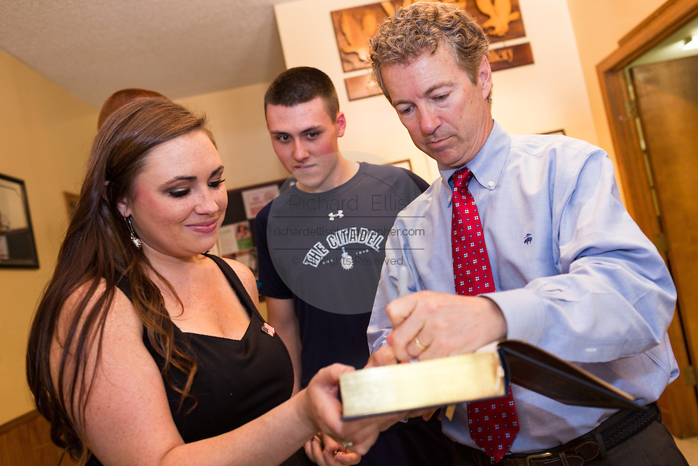 Senator and GOP presidential candidate Rand Paul signs a copy of his book for a supporter at the Veterans of Foreign Wars post June 15, 2015 in Lexington, South Carolina. Paul told the crowd that the country is suffering from Bush-Clinton fatigue.