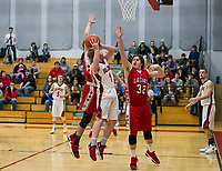 Belmont's Nate Sottak goes up for a shot with pressure from Laconia's Jakob Steele and Jacob Miner during NHIAA Division III Basketball Tuesday evening.  (Karen Bobotas/for the Laconia Daily Sun)
