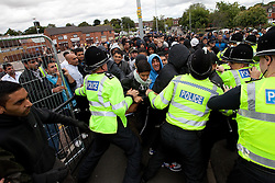 © Licensed to London News Pictures. 13/08/2011. Telford, UK. A demonstration against the EDL in the small Telford town of Willington. The crowd try to break through police lines separating those opposed to the EDL and the EDL. The EDL were going to march, however the Home Secretary imposed a ban on all marches in the area. About 300 EDL supporters attended. The EDL demonstration was counter-protested by about 300 people. Photo credit : Joel Goodman/LNP