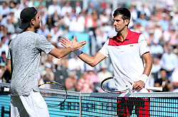 Novak Djokovic (right) shakes hands with Adrian Mannarino after winning against him during day five of the Fever-Tree Championship at the Queen's Club, London.