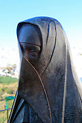 Statue close up of traditional clothes worn by women in Vejer de la Frontera, Cadiz province, Spain