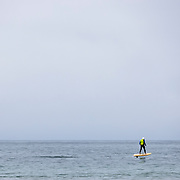 A man uses a hoverboard in the surf in Malibu, California.