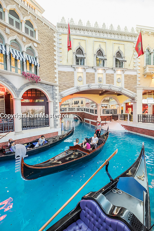 Canal and Gondolas on canal inside The Venetian Macao  casino and hotel in Macau China