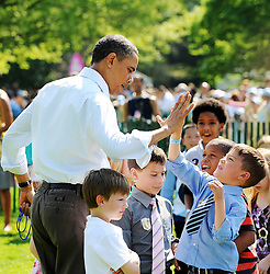 U.S. President Barack Obama gives a high five to a kid during the Annual Easter Egg Roll on the South Lawn of the White House in Washington, DC, USA on April 25, 2011. The first White House Easter Egg Roll took place in 1878, when president Rutherford Hayes invited local children to roll eggs on the South Lawn. Photo by Olivier Douliery/ABACAPRESS.COM  | 272398_003 Washington Etats-Unis United States