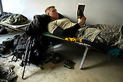 U.S. Army Sgt. Andrew Benson from Alpha Company, 1st Cavalry Division, 12th Infantry Regiment, reads a book during his down time at the Iraqi Police Emergency Response Force building in Baqubah, Iraq on Jan. 23, 2007.