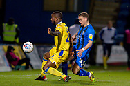Bristol Rovers midfielder Abu Ogogo (25) and Gillingham FC midfielder Mark Byrne (33) during the EFL Sky Bet League 1 match between Gillingham and Bristol Rovers at the MEMS Priestfield Stadium, Gillingham, England on 12 March 2019.