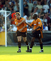 Photograph: Scott Heavey.<br />Bristol Rovers v Wolverhampton Wanderers.<br />14/7/2003.<br />Shaun Newton celebrates with goalscorer John Melligan during this friendly match at the home of Bristol Rovers, The Memorial Ground.
