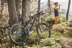 Bicycle parked at forest