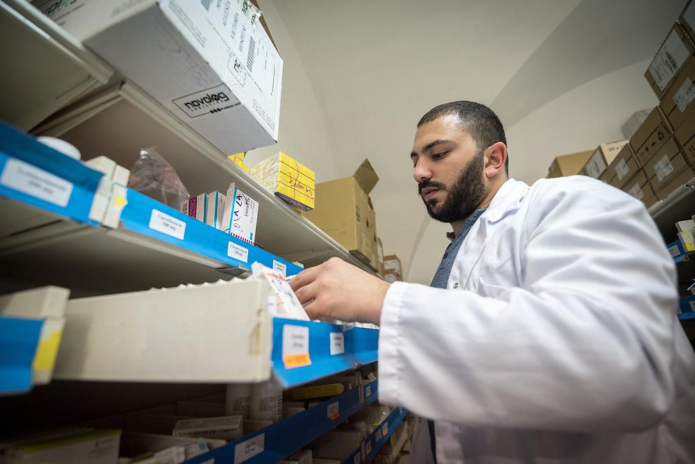 24 February 2020, Jerusalem: Dr Farmacist Nicolas Saliba restocks medicine at Augusta Victoria Hospital.