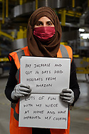 This is Faiza Siddiqui's first job. She is pictured inside Amazon Fulfillment Center Man 3 Near Bolton.  She has worked at Amazon for 8 weeks, she is from Ashton Underlyne. She was asked to write two ways she felt the COVID 19 Lockdown had impacted herself.