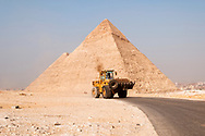 A Caterpillar bulldozer drives down a road at the Giza Pyramids in Egypt. (March 2010)