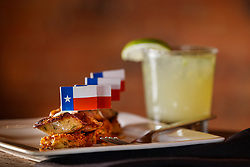 Rabbit-rattlesnake Sausage topped with Texas flags and jalapeño margarita, Lonesome Dove, Forth Worth, Texas, USA. Lonesome Dove is owned by Tim Love.