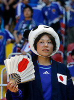 Photo: Glyn Thomas.<br />Australia v Japan. Group F, FIFA World Cup 2006. 12/06/2006.<br /> A Japan supporter with a fan.