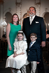 12 May 2013. New Orleans, Louisiana,  USA. .Sarah Christopher and brother Liam with dad Peppa and mother Caroline Tierney at her first Communion at Mater Dolorosa Church..Photo; Charlie Varley.