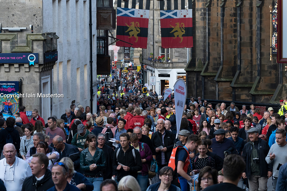 Edinburgh, Scotland, UK. 5 August, 2019.  The Royal Edinburgh Military Tattoo forms part of the Edinburgh International festival. Pictured; Crowds of people make their way up the Royal Mile to the castle esplanade and grandstands.
