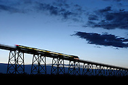 A New Jersey Transit passenger train travels over the Moodna Viaduct railroad trestle in Salisbury Mills at twilight on April 13, 2006.
