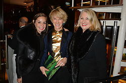 Left to right, CAROL SILLER, SIAN SUTHERLAND and ? at a dinner in honour of Christy Turlington hosted by Porter magazine at Mr Chow, Knightsbridge, London on 18th November 2014.