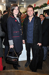 LADY LAURA CATHCART and MILES FROST at the launch party for the Vicomte A boutique in London at 113 King's Road, London SW3 on 13th December 2012.