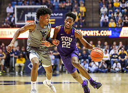 Jan 14, 2020; Morgantown, West Virginia, USA; TCU Horned Frogs guard RJ Nembhard (22) drives against West Virginia Mountaineers guard Miles McBride (4) during the first half at WVU Coliseum. Mandatory Credit: Ben Queen-USA TODAY Sports