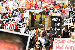 © Licensed to London News Pictures . 13/07/2018. London, UK. Placard featuring British Prime Minister Theresa May and US President Donald Trump . Demonstrators march from Portland Place to Trafalgar Square in protest against US President Donald Trump's UK visit . Photo credit: Joel Goodman/LNP