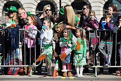 A family of spectators watch the parade along Piccadilly to celebrate St. Patrick's Day in London, Britain, on March 13, 2016. EXPA Pictures © 2016, PhotoCredit: EXPA/ Photoshot/ Ray Tang<br /> <br /> *****ATTENTION - for AUT, SLO, CRO, SRB, BIH, MAZ, SUI only*****