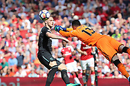 Arsenal goalkeeper David Ospina (13) punches clear from West Ham United midfielder Marko Arnautovic (7) during the Premier League match between Arsenal and West Ham United at the Emirates Stadium, London, England on 22 April 2018. Picture by Bennett Dean.
