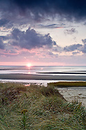 The sun sets at First Encounter Beach in Eastham.