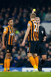 Michael Dawson of Hull City is shown a yellow card by referee Robert Madley - Photo mandatory by-line: Rogan Thomson/JMP - 07966 386802 - 03/12/2014 - SPORT - FOOTBALL - Liverpool, England - Goodison Park - Everton v Hull City - Barclays Premier League.