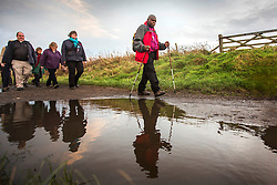 © Licensed to London News Pictures. 02/12/2015. Robin Hood's Bay UK. Dr John Sentamu, The Archbishop of York has begun a six month pilgrimage around Yorkshire. He will walk between each of the 21 deaneries of the Diocese of York & is inviting members of the public to join him. He will travel through the Archdeaconry of the East Riding and finish at York Minster on 22 May next year. Photo credit:  Andrew McCaren/LNP