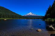 USA, Oregon, Trillium Lake, paddlers on lake in front of Mt. Hood.