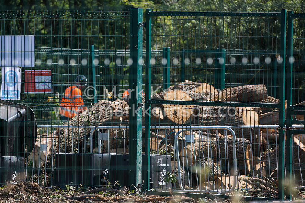 Large sections of trunk from a felled mature oak tree are seen in a compound used by contractors working on the HS2 high-speed rail project on 26th June 2020 in Harefield, United Kingdom. Activists from HS2 Rebellion and Extinction Rebellion UK, some of whom living in the tree, had sought to prevent its destruction for several months as part of an ongoing protest against the environmental impact of the high-speed rail link and the cost of the £100bn+ project.