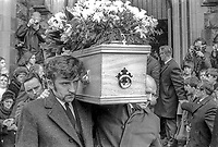 William & Bobby Deane, brothers of Martha Crawford, a mother of ten young children, carry  her coffin from the church following a funeral mass in West Belfast, N Ireland. She died during an exchange of fire initiated by the Provisional IRA shooting at British soldiers on patrol in West Belfast. In 1977 two men, aged 16 and 18, at the time of the shooting, were given life sentences for her murder. 3rd April 1972, 197204030159b<br /> <br /> Copyright Image from Victor Patterson, Belfast, UK<br /> <br /> t: +44 28 9066 1296 (from Rep of Ireland 048 9066 1296)<br /> m: +44 7802 353836<br /> e: victorpattersonbelfast@gmail.com<br /> <br /> www.images4media.com<br /> <br /> Please see my full Terms and Conditions of Use at https://www.images4media.com/p/terms-conditions - it is IMPORTANT that you familiarise yourself with them.<br /> <br /> Images used online incur an additional cost. This cost should be agreed in writing in advance. Online images must be visibly watermarked i.e. © Victor Patterson or that of the named photographer within the body of the image. The original metadata must not be deleted from images used online.<br /> <br /> This image is only available for the use of the download recipient i.e. television station, newspaper, magazine, book publisher, etc, and must not be passed on to a third party. It is also downloaded on condition that each and every usage is notified within 7 days to victorpattersonbelfast@gmail.com.<br /> <br /> The right of Victor Patterson (or the named photographer) to be identified as the author is asserted in accordance with The Copyright Designs And Patents Act (1988). All moral rights are asserted.